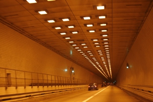 "Monitor-Merrimac Bridge-Tunnel: ""Bridge-tunnels and waterways facilitate vessel passage towards ports like the doors of an open house."""