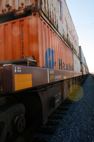 """""""Rail tracks carry container trains to and from inspection points, tracing the familiar and well-tread corridors of their home."""""""